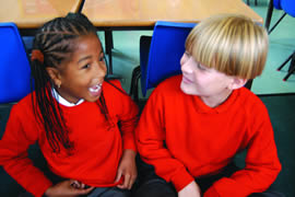 boy and girl laughing at school
