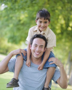Son Riding on Father's Shoulders