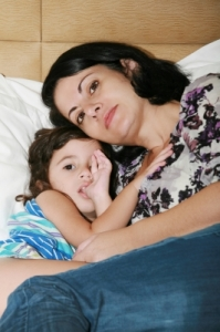 Beautiful Young Mother And Her Daughter On The Bed by David Castillo Dominici