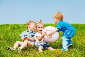 Angry toddlers fighting for the ball