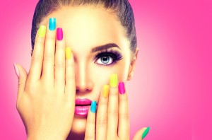 Beauty Girl Face with Colorful Nail polish. Colourful Studio Sho