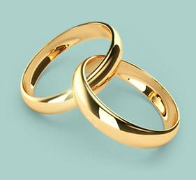 Connected wedding rings representing the union of marriage and commitment of spouses for life