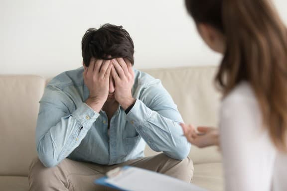 A patient receiving trauma counseling and therapy at Total Life Counseling